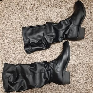 Black heeled zip up boots